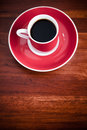 Red coffee cup black coffee wooden table space text Royalty Free Stock Images