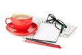 Red coffee cup, glasses and office supplies Royalty Free Stock Photo