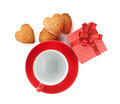 Red coffee cup and heart shaped cookies and gift box Royalty Free Stock Image
