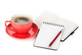 Red coffee cup and office supplies isolated on white background Royalty Free Stock Photography