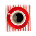 Red coffee cup over kitchen towel view from above isolated on white background Stock Image
