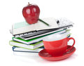 Red coffee cup, ripe apple and office supplies Royalty Free Stock Photos