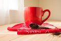 Red Coffee Mug with Napkin and Grounds Royalty Free Stock Photo