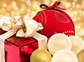 Red colorful christmas gift xmas holiday glossy presents for with white and gold baubles bright golden bokeh background two Stock Photography