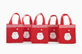Red colour christmas gifts bags with santaclaus face Royalty Free Stock Photo