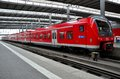 Red commuter train parked at munich station germany a waits hauptbahnhof the electric is part of deutsche bahn s fleet deutsche Stock Images