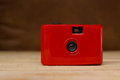 Red compact film camera. Royalty Free Stock Photo