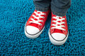 Red converse sneakers trendy urban style fashion on a blue background fashion and vintage rebirth Stock Image