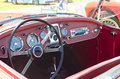 Red convertible vintage sports car with steering wheel and gauges Royalty Free Stock Photography
