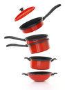 Red cookware set on white background Royalty Free Stock Images
