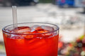 Red cordial drink in a cup with ice and straw Stock Images
