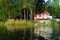 Red cottage at a lake Royalty Free Stock Photos