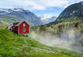 Red cottage. Mist Royalty Free Stock Photo