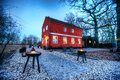 A red cottage at sunset den rode the on blue evening Royalty Free Stock Photos