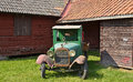 Red cottage wooden in sweden and a old car in front Royalty Free Stock Photos