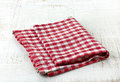 Red cotton napkin on white wooden table Stock Photography