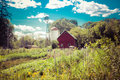 Red Country Barn with Windmill Royalty Free Stock Photo