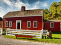 Red country house small with white fence Stock Photo
