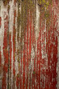 Red cracked painting on wooden surface
