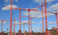 Red cranes on contruction site Royalty Free Stock Image