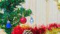 Red crismas ball on tree on wooden background Royalty Free Stock Photo