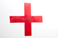 Red cros with insulating tape Stock Photography