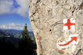 Red cross and arrow hiking symbols Royalty Free Stock Photo