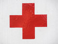 Red cross sign on white metal background Royalty Free Stock Photo