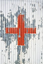 Red cross on the white metal background Royalty Free Stock Images