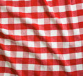 Red crumpled linen gingham picnic tablecloth and white Stock Image
