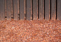 Red crushed gravel with wood wall Royalty Free Stock Photo