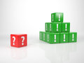 Red cube with question mark in front of a tower of green cubes exclamation marks symbol for and answer Royalty Free Stock Photos