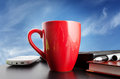 Red cup on a background of blue sky coffee in office Royalty Free Stock Photos