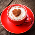 Red cup cappuccino heart decoration over foam valentine s day cup love concept Stock Photos