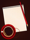 Red cup of coffee blank note paper and pencil with stain Stock Image