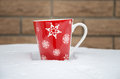 Red cup on snow Royalty Free Stock Photo