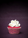 Red cupcake purple background Royalty Free Stock Photography