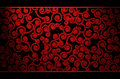 Red curls pattern wallpaper with partially illuminated Royalty Free Stock Images