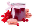 Red currant jam glass jar of with fresh berries and pink macaroon over white Royalty Free Stock Images