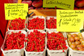Red currants and gooseberries on the market for sale Stock Photography