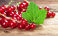 Red currants with leaf on wood fresh old in a rural style Stock Photo
