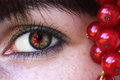 Red currants the are reflected in the eye of a woman Stock Photography
