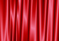 Red curtain reflect with light spot on background.