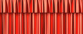 Red curtain seamless background horizontaly with gathers under the lights Stock Photos