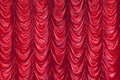 Red curtain symmetrical background and wallpaper Stock Photo