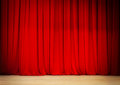Red curtain of theater stage on wooden Royalty Free Stock Images