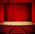 Red curtain on theater wood stage with red velvet