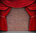 Red Curtains On A Brick Wall Royalty Free Stock Photos