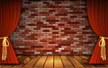 Red curtains on  brick wall Royalty Free Stock Photo