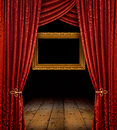 Red curtains and gold frame Royalty Free Stock Photo